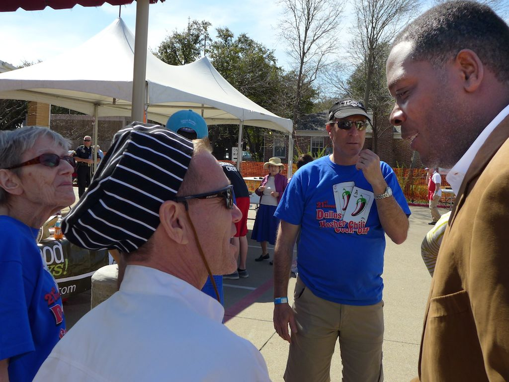 dallas county district attorney craig watkins chats with a guest at the dallas kosher chili cook-off