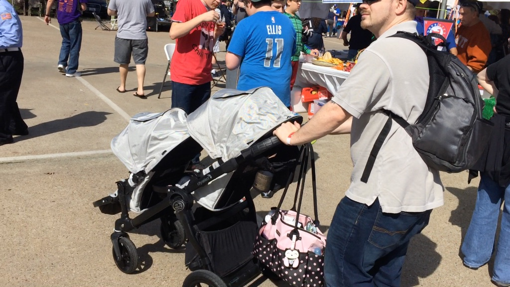 A dad navigates a duo stroller through the Kosher Chili Cook-off.