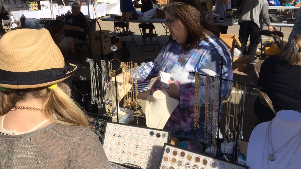 Vendors engage interested customers at the Kosher Chili Cook-off.