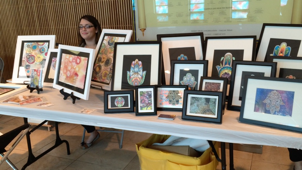 Vendors offer paintings at the Kosher Chili Cook-off.